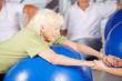 canvas print picture - Seniorin macht Fitness in der Reha