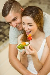 Couple eating fruit salad at breakfast