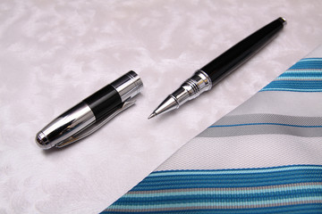Business pen and tie composition background