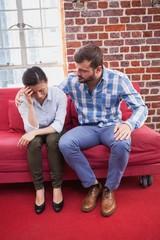 Therapist comforting his upset patient