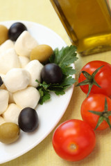 Mozzarella, olives, cherry tomatoes and olive oil.