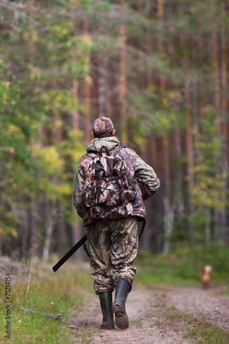 Fotobehang Jacht hunter walking on the road