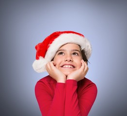 Composite image of festive little girl smiling and looking up