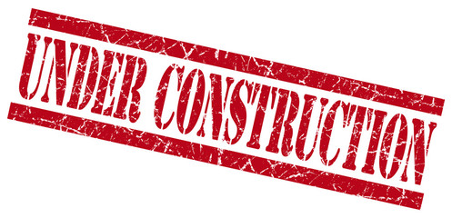 under construction red square grunge textured isolated stamp