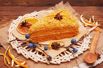 Orange cake on a wooden background