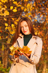 portrait of young beautiful woman girl on autumn background