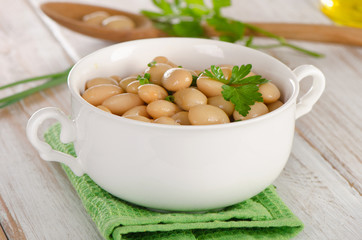 Beans with fresh parsley   on   wooden table.
