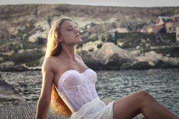 Blonde woman basking in the sun