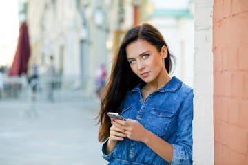 Young woman reading a message on the phone