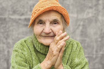 Portrait of a happy senior woman smiling at the camera.