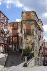 Old, abandoned and empty street of Lisbon, Portugal.