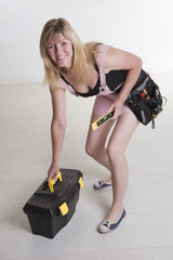 DIY woman with tools and toolbox