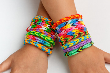 A kid's with rainbow color loom band
