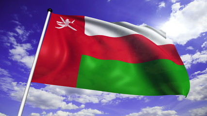 flag of Oman with fabric structure against a cloudy sky