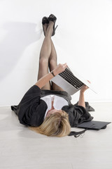 Female University student laying on floor using laptop