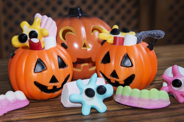Candies and pumpkins in Halloween festivities