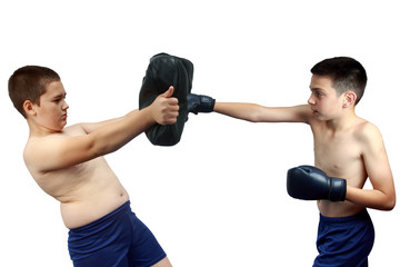 Two athletes train blows to the body on a white background