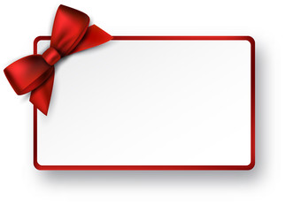 White paper gift card with red satin bow.