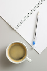 open notebook and cup of coffee
