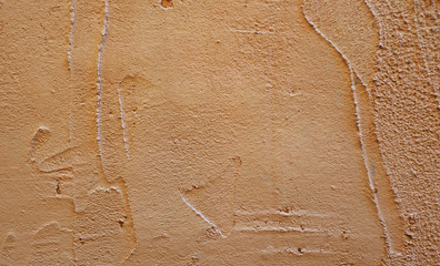 coarse brown plaster on the wall of the building