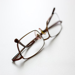 close up of spectacles on desk
