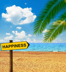Tropical beach and direction board saying HAPPINESS
