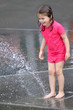 Child play water with water fountain