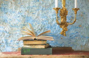 stack of old books, candleholder, free copy space