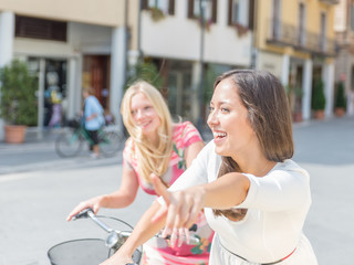 two beauiful girls on their bicycle