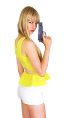 Cute blonde with revolver turning and looking
