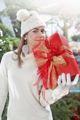 girl in a Christmas shop with red gift box
