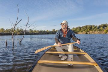 paddling canoe on a lake