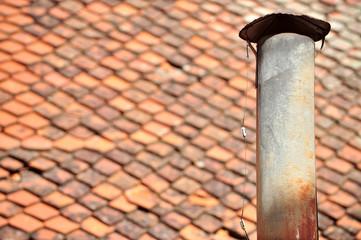 Rusty tin chimney