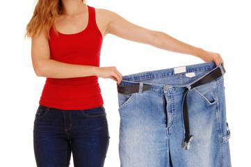 Woman holding big pants.