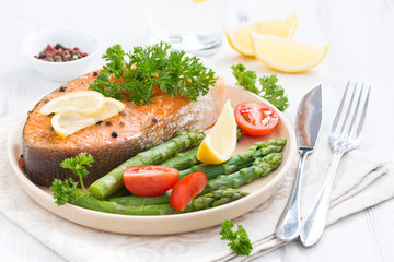 baked salmon with asparagus, parsley and lemon