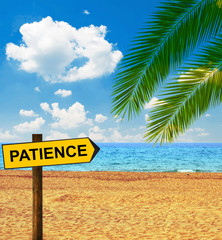 Tropical beach and direction board saying PATIENCE