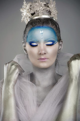 Close up of a model with creative snow fairy make up