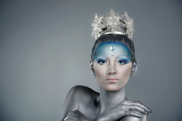 Portrait of a woman with professional make up as Snow Queen