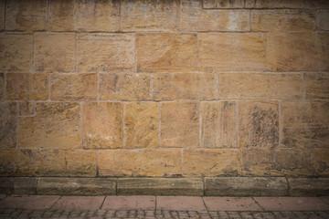 Hintergrund - gelbe Sandsteinmauer