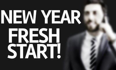 Business man with the text New Year Fresh Start