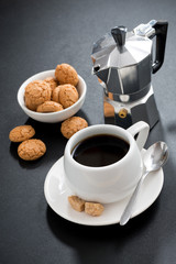 cup of coffee and italian cookies biscotti on black background