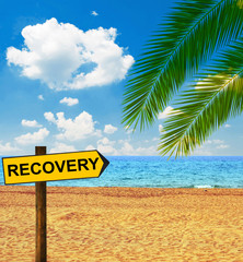 Tropical beach and direction board saying RECOVERY