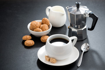 cup of coffee, cream and italian cookies biscotti