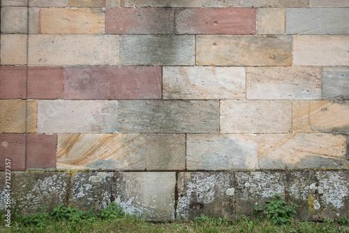 canvas print picture Hintergrund – bunte Sandsteinmauer