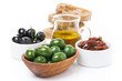 green and black olives, sun-dried tomatoes, jar with olive oil