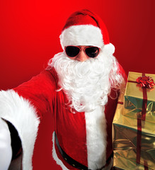 Selfie of Santa Claus with gifts