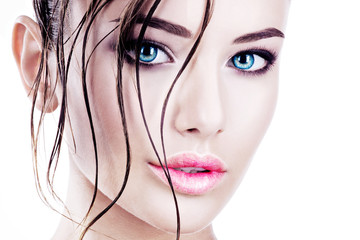 Beautiful face of a woman with bright blue eyes