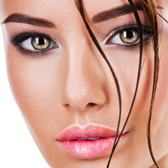 Beautiful face of a woman with dark brown eye makeup