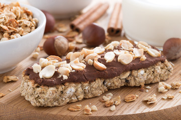 oat bar with chocolate on wooden board, selective focus
