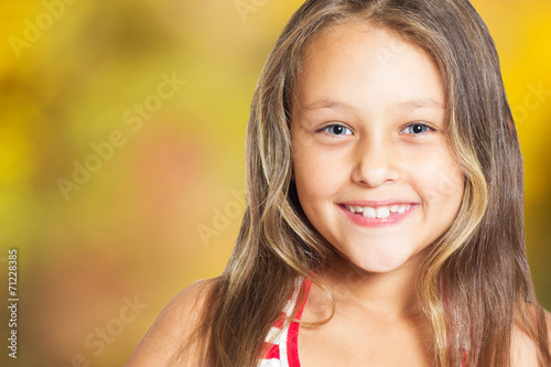 canvas print picture portrait of a smiling girl on autumn background